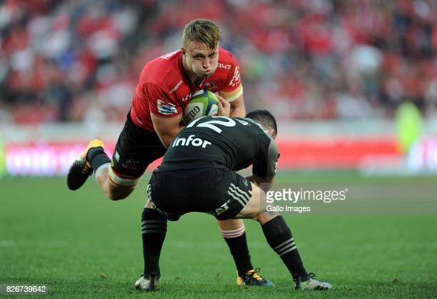 Ruan Ackermann of Lions is tackled by Ryan Crotty of Crusaders during the Super Rugby Final match between Emirates Lions and Crusaders at Emirates...