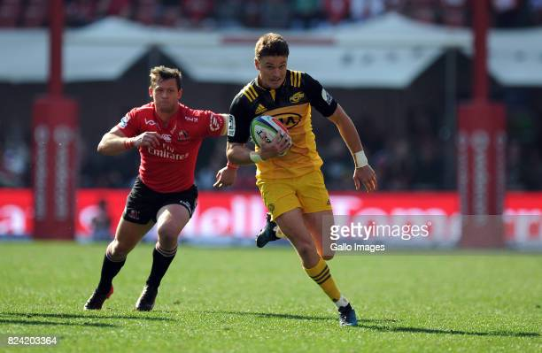 Ruan Combrick of Lions in action with Beauden Barrett of Hurricane during the Super Rugby Semi Final match between Emirates Lions and Hurricanes at...