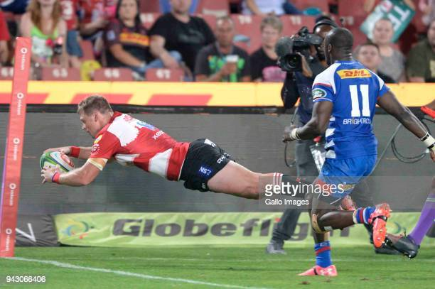 Ruan Combrinck of the Emirates Lions scores during the Super Rugby match between Emirates Lions and DHL Stormers at Emirates Airline Park on April 07...