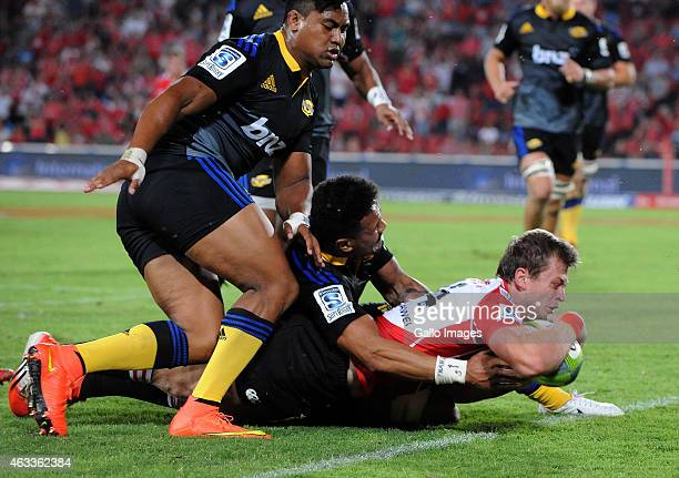 Ruan Combrinck of the Lions dives over for his try during the Super Rugby match between Emirates Lions and Hurricanes at Emirates Airline Park on...