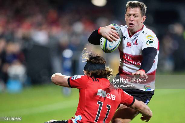 Ruan Combrinck of the Lions is tackled by George Bridge of the Crusaders during the Super Rugby Final match between the Crusaders and the Lions at...