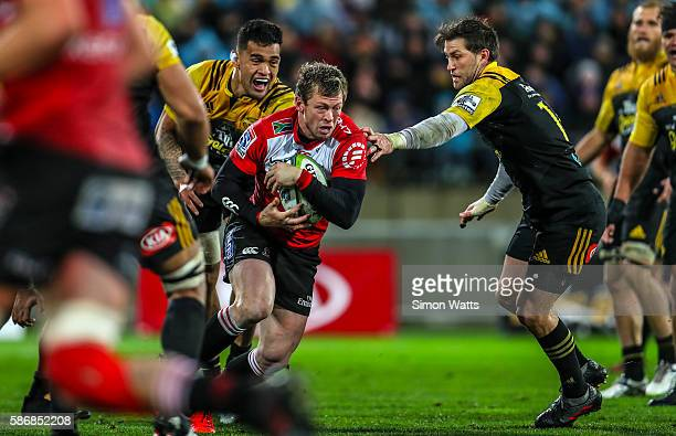 Ruan Combrinck of the Lions looks to beat the tackle of Cory Jane of the Hurricanes during the 2016 Super Rugby Final match between the Hurricanes...