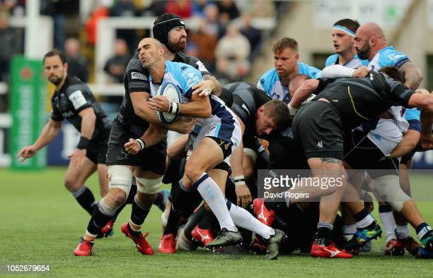 Ruan Pienaar of Montpellier is held by Gary Graham during the Champions Cup match between Newcastle Falcons and Montpellier Herault Rugby at Kingston...