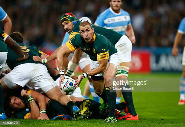 Ruan Pienaar of South Africa passes the ball during the 2015 Rugby World Cup Bronze Final match between South Africa and Argentina at the Olympic...