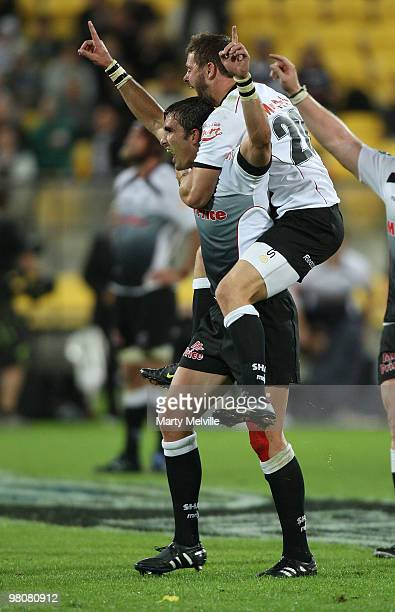 Ruan Pienaar of the Sharks celebrates their win with team mate Jean Deysel during the round seven Super 14 match between the Hurricanes and the...