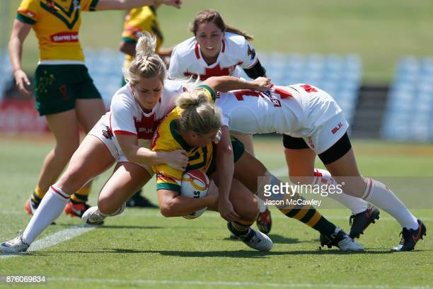 Ruan Sims of Australia is tackled during the 2017 Women's Rugby League World Cup match between Australia and England at Southern Cross Group Stadium...