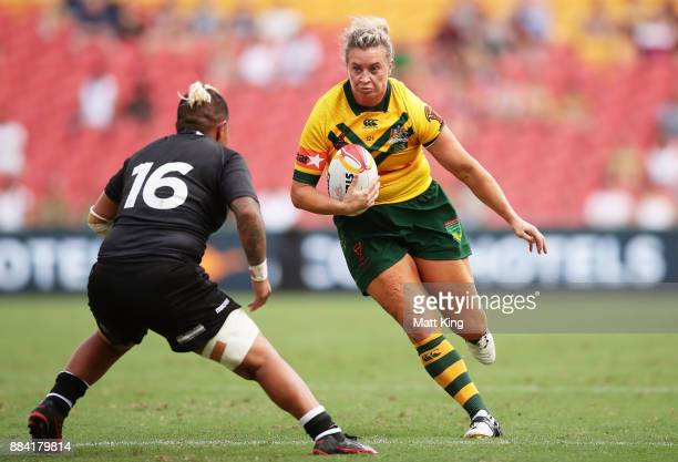 Ruan Sims of Australia runs at the defence during the 2017 Rugby League Women's World Cup Final between Australia and New Zealand at Suncorp Stadium...