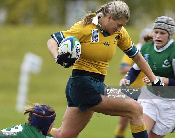Ruan Sims of Australia runs with the ball against Ireland during day five of the Women's Rugby World Cup 2006 at Ellerslie Rugby Football Club on...