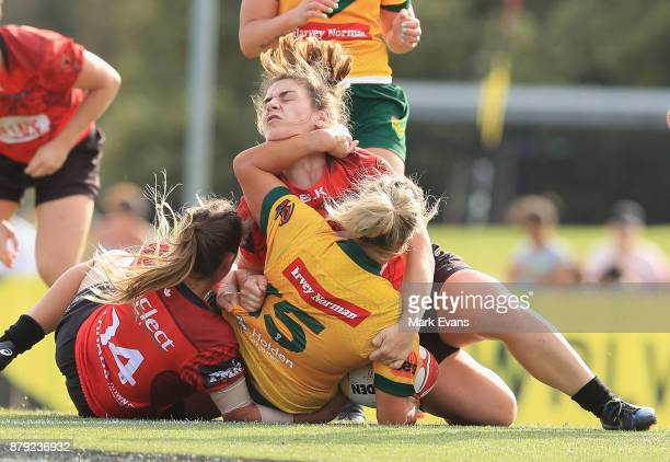 Ruan Sims of Australia tackled during the 2017 Rugby League World Cup Semi Final match between Australia and Canada at Southern Cross Group Stadium...