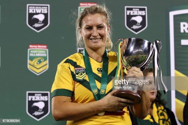 Ruan Sims of the Jillaroos poses with the trophy after victory during the women's ANZAC Test match between the Australian Jillaroos and the New...