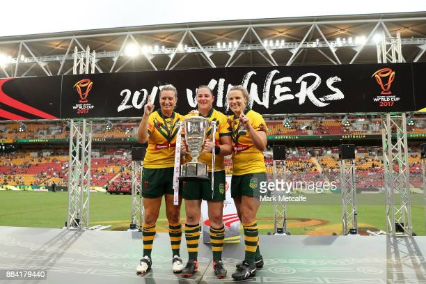 Ruan Sims of the Jillaroos Stephanie Hancock of the Jillaroos and Renae Kunst of the Jillaroos pose with the trophy after winning the 2017 Rugby...