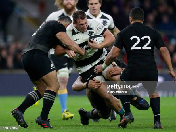Ruan Smith of Barbarians tackled by Ngani Laumape of New Zealand during the Killik Cup match between Barbarians and New Zealand at Twickenham Stadium...