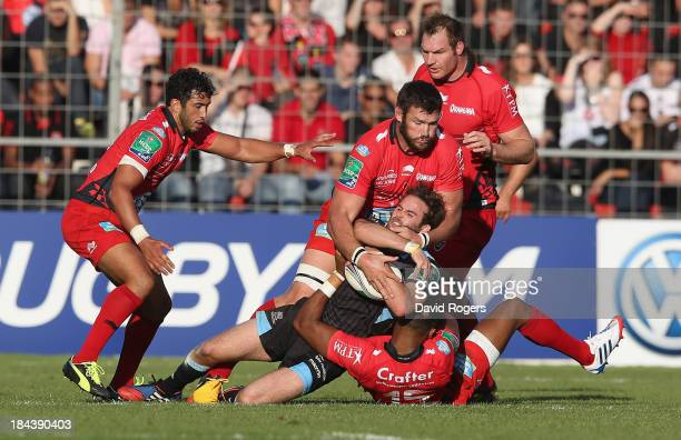 Ruaridh Jackson of Glasgow is tackled by Delon Armitage and Daniel Rossouw during the Heineken Cup Pool 2 match between Toulon and Glasgow Warriors...