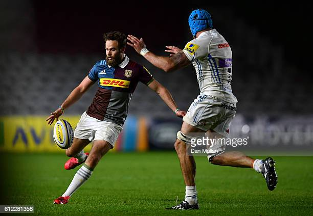 Ruaridh Jackson of Harlequins A kicks under pressure from Ben White of Exeter Braves during the Aviva Premiership A League match between Harlequins A...