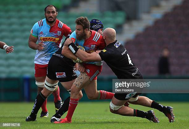 Ruaridh Jackson of Harlequins is tackled by George Robson of London Irish during the Cunningham Duncombe Series match between Harlequins and London...