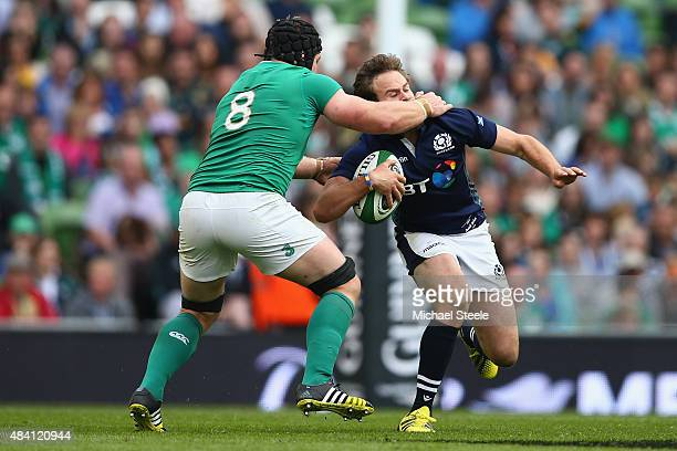 Ruaridh Jackson of Scotland is on the wrong side of a high tackle by Sean O'Brien of Ireland during the International match between Ireland and...