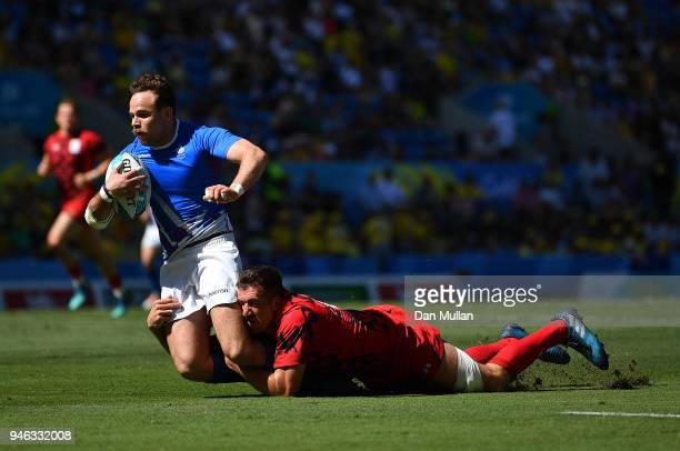 Ruaridh Jackson of Scotland is tackled by Justin Tipuric of Wales during the Rugby Sevens Men's Placing 58th match between Scotland and Wales on day...