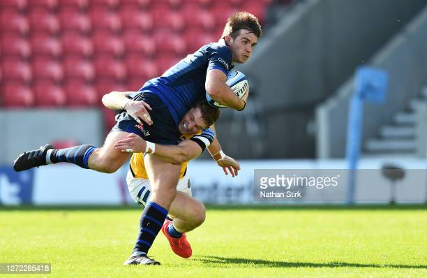Ruaridh McConnochie of Bath attempts to tackle AJ MacGinty of Sale Sharks during the Gallagher Premiership Rugby match between Sale Sharks and Bath...
