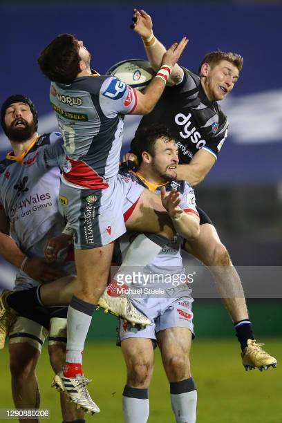 Ruaridh McConnochie of Bath battles for a high ball with Dan Jones and Steff Hughes during the Heineken Champions Cup Pool 1 match between Bath Rugby...