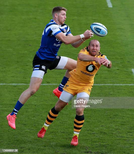 Ruaridh McConnochie of Bath beats Dan Robson to the high ball during the Gallagher Premiership Rugby match between Bath Rugby and Wasps at the...