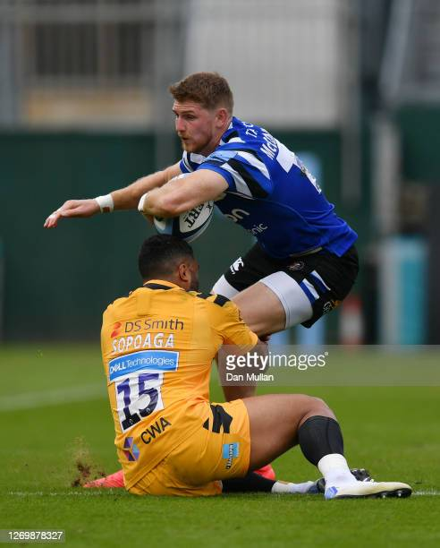 Ruaridh McConnochie of Bath is tackled by Lima Sopoaga of Wasps during the Gallagher Premiership Rugby match between Bath Rugby and Wasps at The...