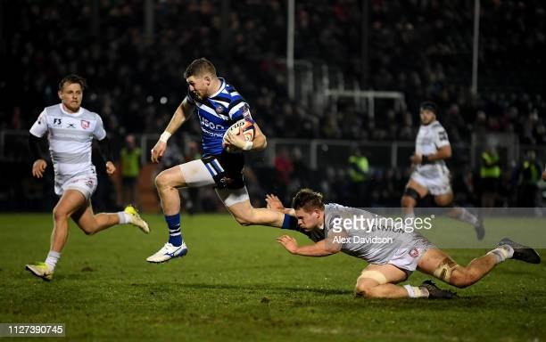 Ruaridh McConnochie of Bath Rugby beats Gareth Evans of Gloucester Rugby to score a try during the Premiership Rugby Cup match between Bath Rugby and...