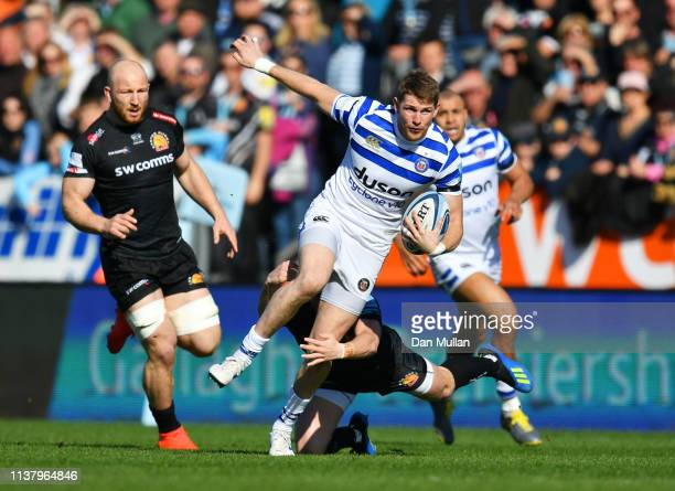 Ruaridh McConnochie of Bath Rugby evades a tackle from Joe Simmonds of Exeter Chiefs during the Gallagher Premiership Rugby match between Exeter...