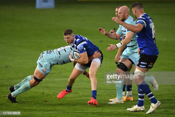 Ruaridh Mcconnochie of Bath Rugby is tackled by Lewis Ludlow of Gloucester Rugby during the Gallagher Premiership Rugby match between Bath Rugby and...