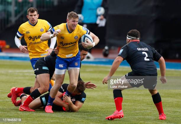 Ruaridh McConnochie of Bath Rugby is tackled my Manu Vunipola of Saracens during the Gallagher Premiership Rugby match between Saracens and Bath...
