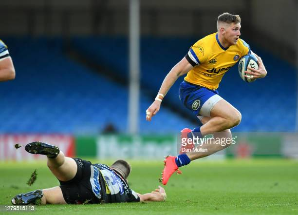 Ruaridh McConnochie of Bath skips past Luke CowanDickie of Exeter Chiefs during the Gallagher Premiership Rugby first semifinal match between Exeter...