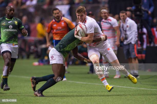 Ruaridh McConnochie of England attempts to get away from Siviwe Soyizwapi of South Africa during the Cup Final on day 2 of the 2017 Canada Sevens...