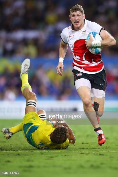 Ruaridh McConnochie of England beats the tackle of Lachlan Anderson of Australia on his way to score a try during the Rugby Sevens match between...