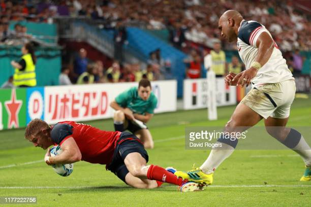Ruaridh McConnochie of England scores his sides fifth try as Paul Lasike of USA steps on his ankle during the Rugby World Cup 2019 Group C game...