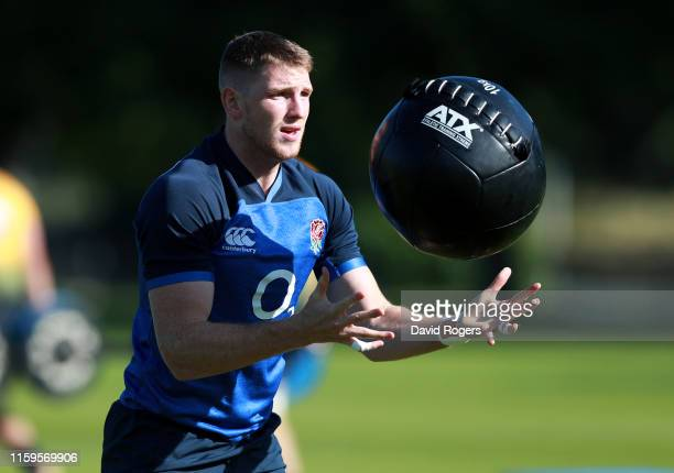Ruaridh McConnochie works out with a medicine ball during the England training session held at the Lensbury Club on July 02 2019 in London England