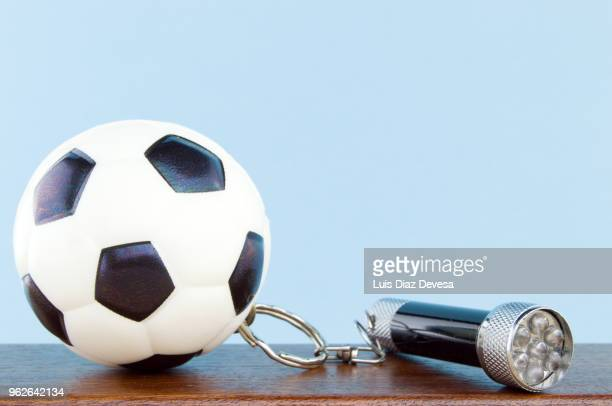rubber ball football keyring holding  flashlight - football league imagens e fotografias de stock