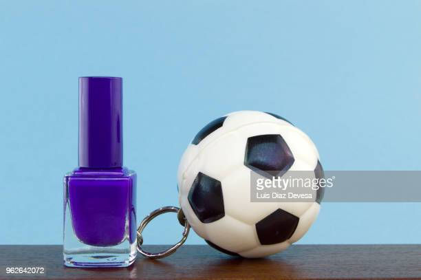 rubber ball football keyring holding  purple  nail polish - football league imagens e fotografias de stock
