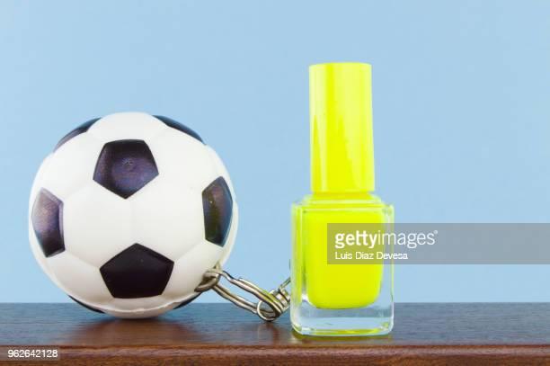 rubber ball football keyring holding  yellow  nail polish - football league imagens e fotografias de stock