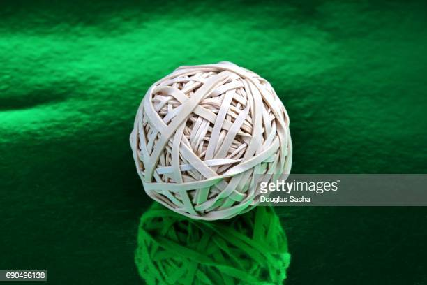 Rubber Band Ball on a green background