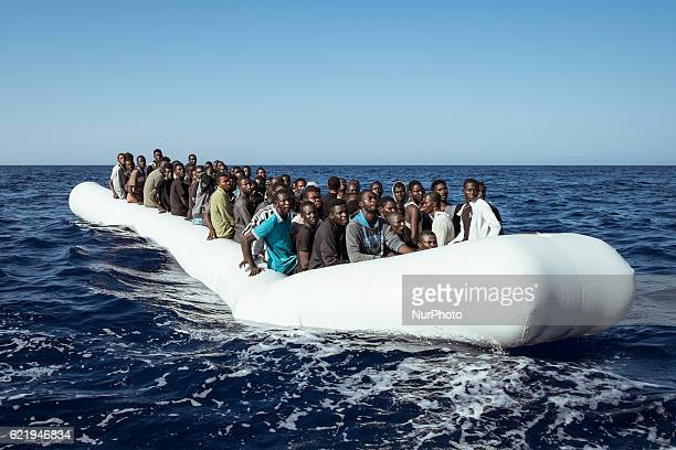 A rubber boat in distress with 120 people on board is found approximately 23 miles northeast of Tripoli on September 11th 2016 Reportage from the...