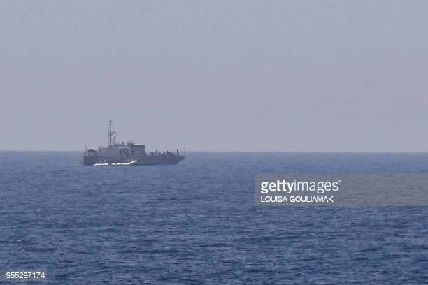 A rubber boat with migrants is intercepted by Libyan coast guard seen from the MV Aquarius a search and rescue ship run in partnership between the...