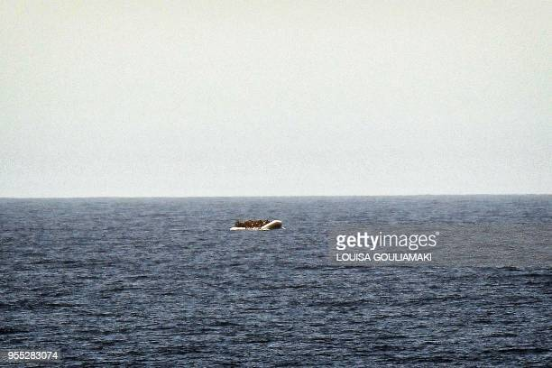 A rubber boat with migrants is seen from the MV Aquarius a search and rescue ship run in partnership with the humanitarian organisations SOS...