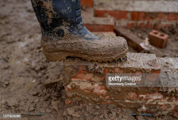 rubber boots covered in mud - wet stock pictures, royalty-free photos & images