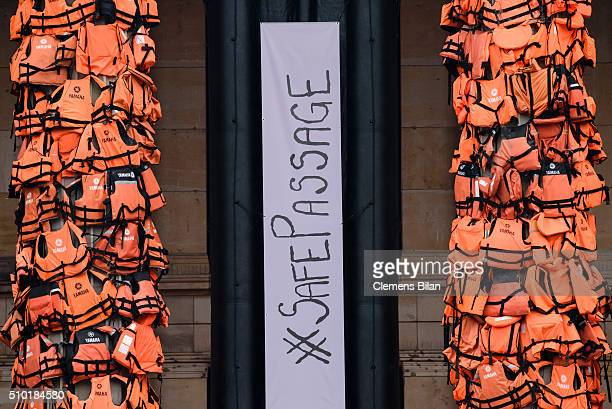 A rubber dinghy with the inscription 'Safe Passage' is shown in an art installation by Chinese artist Ai Weiwei that consists of life vests worn by...