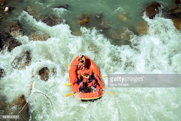 Rubber dinghy with tourists doing rafting in Trentino, Italy.