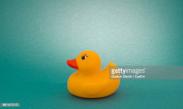 Rubber Duck Against Green Background