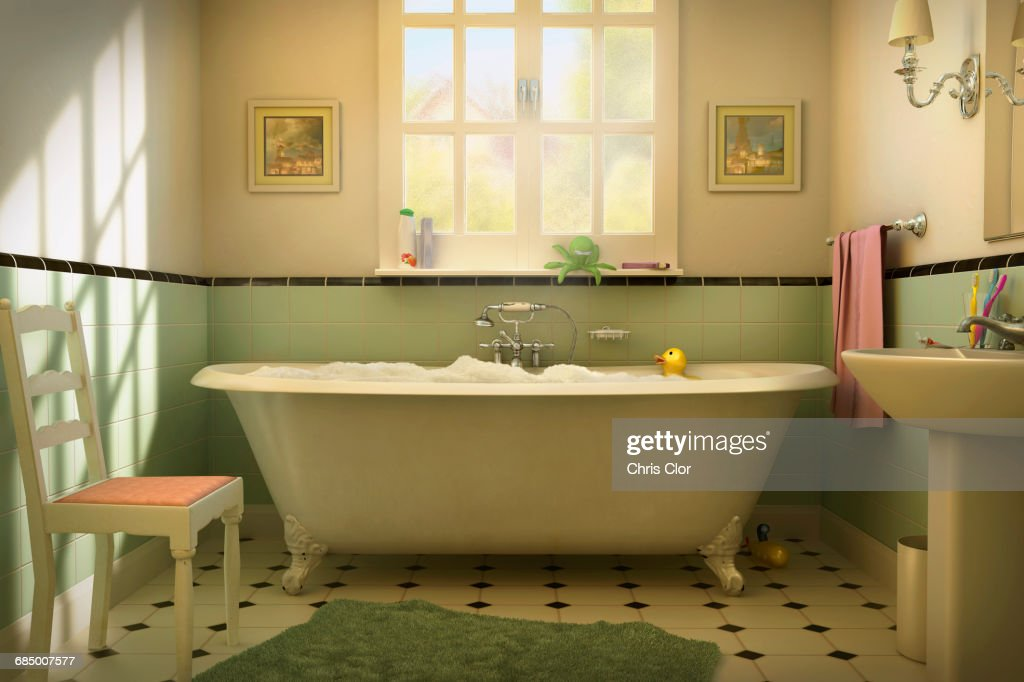 Rubber duck floating in bubble bath : Stock Photo