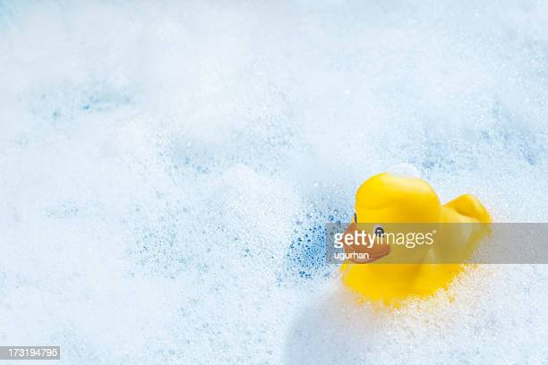 rubber duck - bubble bath stock pictures, royalty-free photos & images
