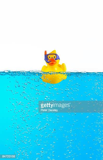 Rubber duck with scuba mask in blue water