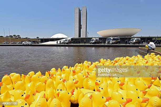 Rubber ducks are seen in the pond of the Brazilian Congress during a protest of the National Industry Confederation against creation of new taxes on...