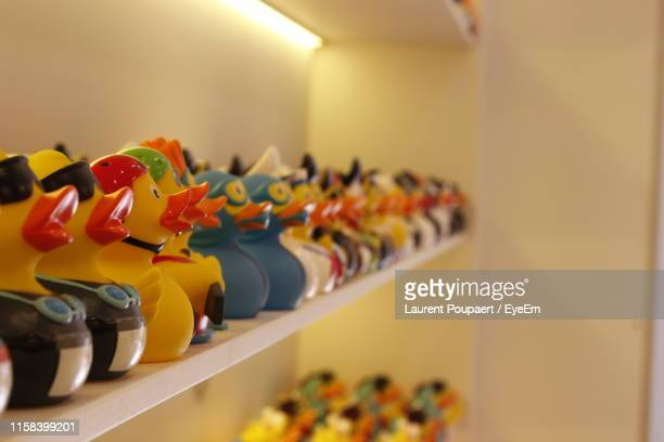 rubber ducks in row on shelves at store - eyeem collection stock pictures, royalty-free photos & images